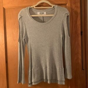 Long sleeve grey sweater with cut out shoulder
